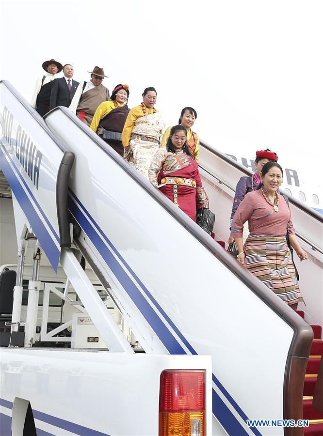 Delegates of Tibet Autonomous Region to the 19th National Congress of the Communist Party of China (CPC) arrive at Capital International Airport in Beijing, capital of China, Oct. 15, 2017. The congress will start on Oct. 18. (Xinhua/Ding Haitao)
